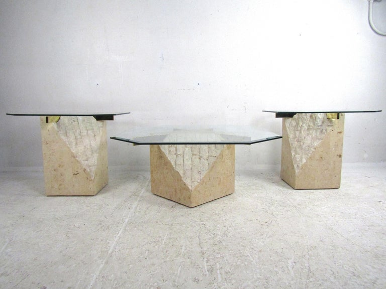 Stunning set of 3 midcentury Artedi style coffee and side tables. Faux-stone bases with brass cross-sections support 1/4 inch glass tabletops with beveled edges. Great set of tables sure to liven up any modern interior. Please confirm item location