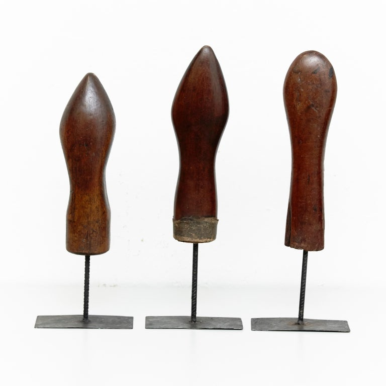 Set of 3 Mid-Century Modern wood and metal sculptures, circa 1950 By Unknown Artist, manufactured in Spain, circa 1950.  In original condition with minor wear consistent of age and use, preserving a beautiful patina.  Beautiful Artworks, very