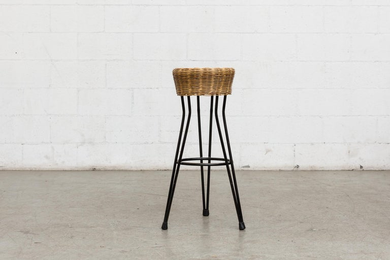 Set of 3 midcentury bar stools with woven rattan seats and black metal hairpin legs. Good original condition with visible signs of wear consistent with its age and usage. Similar single bar stool also available (LU922412763522).
