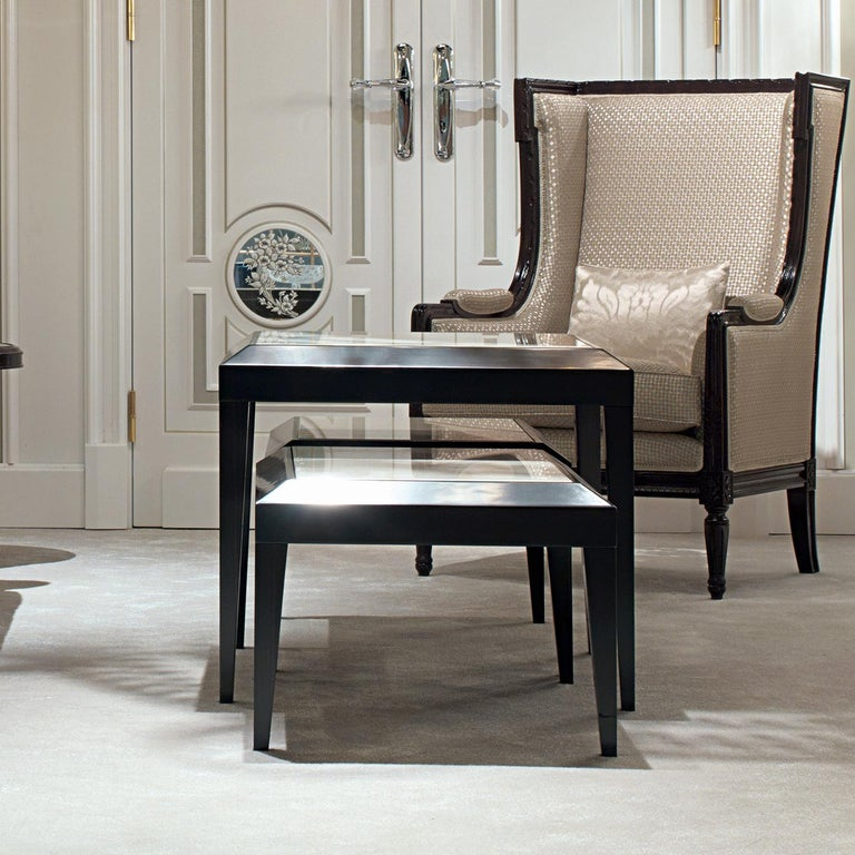 Sophisticated and timeless, these three side tables are a celebration of exquisite craftsmanship. Their wooden structure, veneered in striking ebony, support an Estremoz marble top. Either together, as a cluster, or displayed separately around the