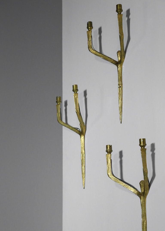 Set of 3 Felix Agostini wall lights sconces golden bronze.