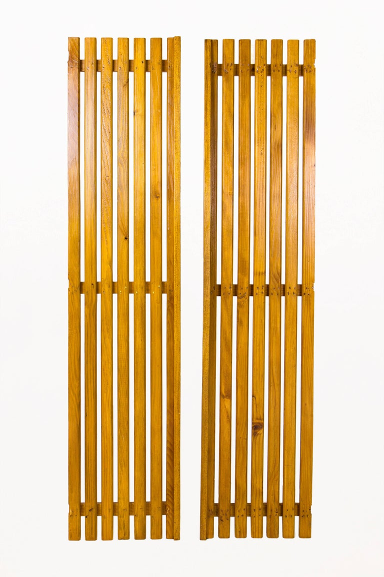 Set of three pairs of Charlotte Perriand large slat doors Hisotry: Le Courboulay Building, Le Mans, France Provenance: Gallery Clément Cidivino, circa 1950, France Very good vintage condition.