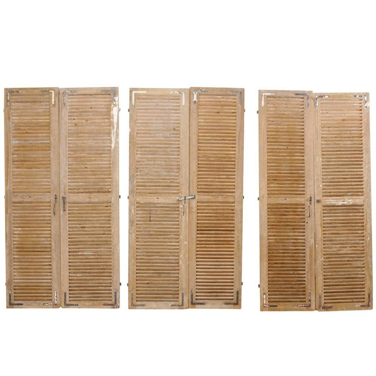 Set of Three Pairs of French 19th Century Natural Wood Shuttered Doors
