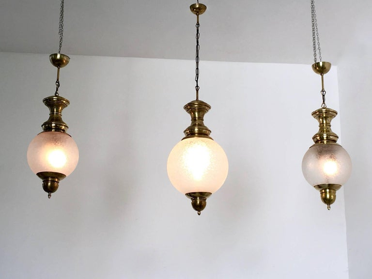 Made in etched blown glass and brass, 1950s. In very good original condition: they may show slight traces of use but the lampshades are in perfect condition.   Small ones:  diameter 25 H, 75 cm   Big one:  diameter 30 H, 110 cm.