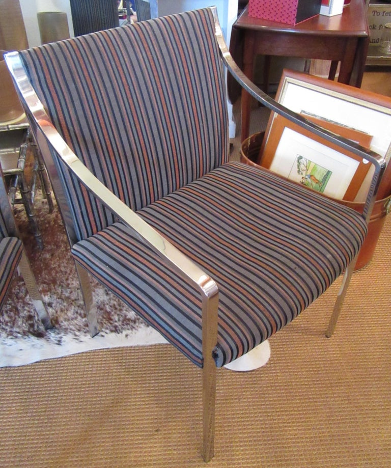 Three vintage chrome frame armchairs with upholstered seats and backs. The upholstery is original.