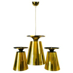 Set of 3 Polished Brass Pendant Lamps Attributed to Paavo Tynell, 1950s