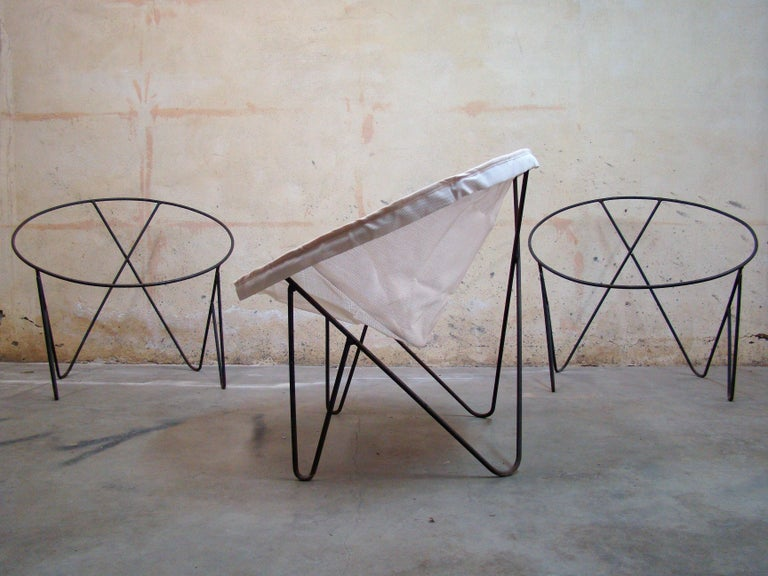 Set of three matching 1950s steel hoop poolside lounge chairs. Frames only, no upholstery. Hairpin style front legs with a
