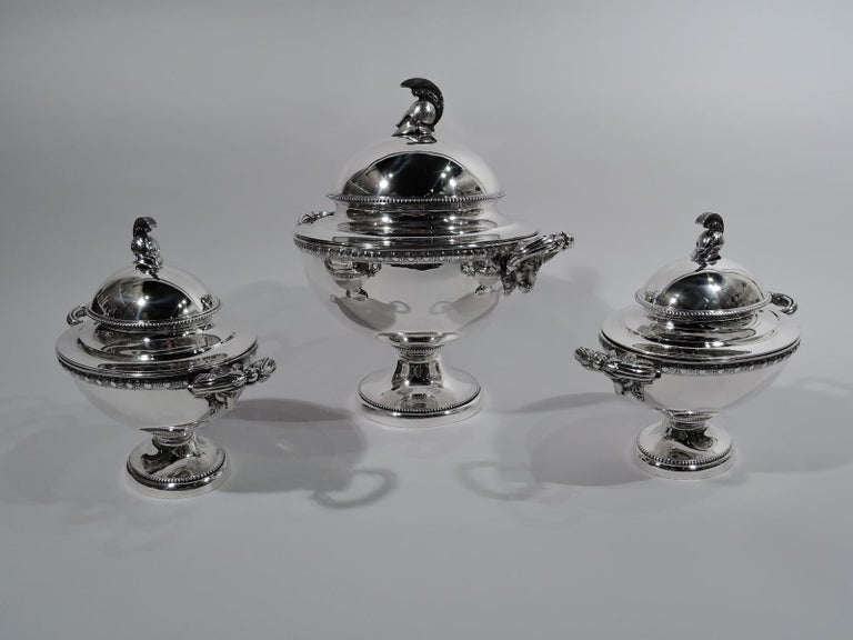 Set of 3 Etruscan Revival sterling silver tureens. Made by JC Moore & Son for Tiffany & Co. in New York, circa 1865. This set comprises 1 large round tureen and 2 small oval tureens.  Each: Tapering, ovoid body on raised foot. Egg-and-dart border.