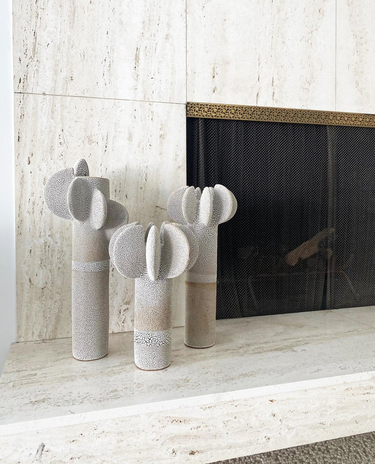 Set of 3 tempo sculptures by Olivia Cognet Materials: Ceramic Dimensions: Tall around 55 cm tall   Medium 45 cm tall      Tempo Dynamic sculptures decorated with textured, subtly imperfect disks, in which repetition echoes the art of