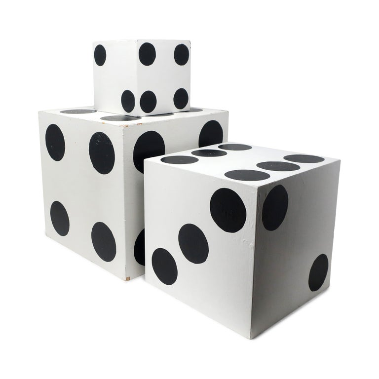 A set of three giant dice. Handmade, hand painted, and designed with one open side to nest inside of each other. Perfect on a table or shelf as decorative objects or for use as bookends.  In good vintage condition with wear consistent with age.