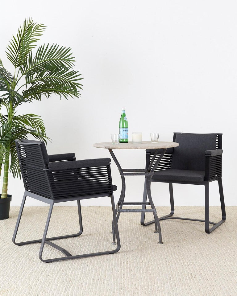 Stylish set of 30 Kettal Studio aluminum dining armchairs landscape design model #941000. These chairs are for indoor and outdoor use constructed from lightweight weatherproof powder coated aluminum. The frame features black rope sides and back with