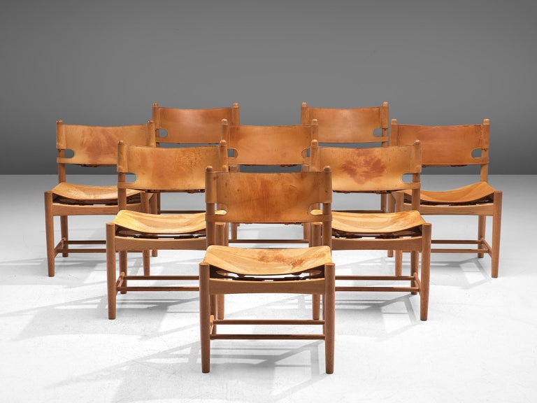 Børge Mogensen for Fredericia Stolefabrik, set of 8 chairs model 3237, in oak and leather, Denmark, 1964.  Set of eight chairs in solid oak. These chairs remind of the classical foldable 'director-chairs', yet this design by Danish designer Børge