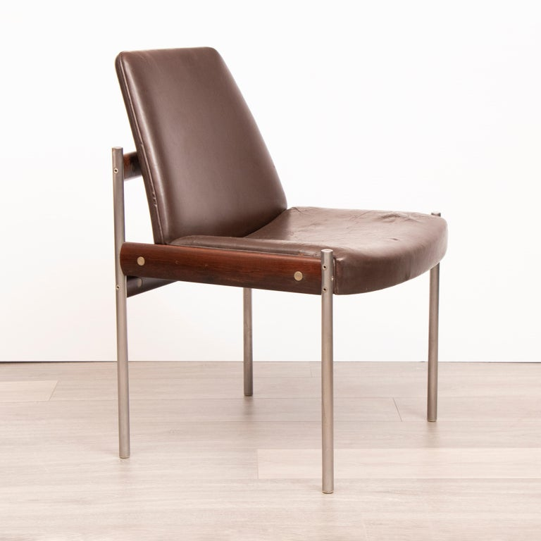 Set of 4 original dining chairs designed by Sven Ivar Dysthe and manufactured by Dokka Mobler in Norway. The frame is manufactured from a combination of Rosewood, chrome-plated metal tubes and brown leather upholstery.
