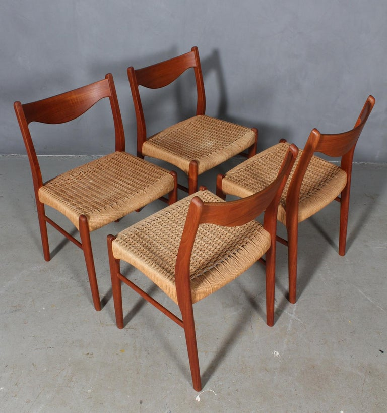 Four dining chairs designed by Arne Wahl, model GS61 for Glyngore Stolefabrik.   Chairs crafted of partly solid teak with paper cord seats.