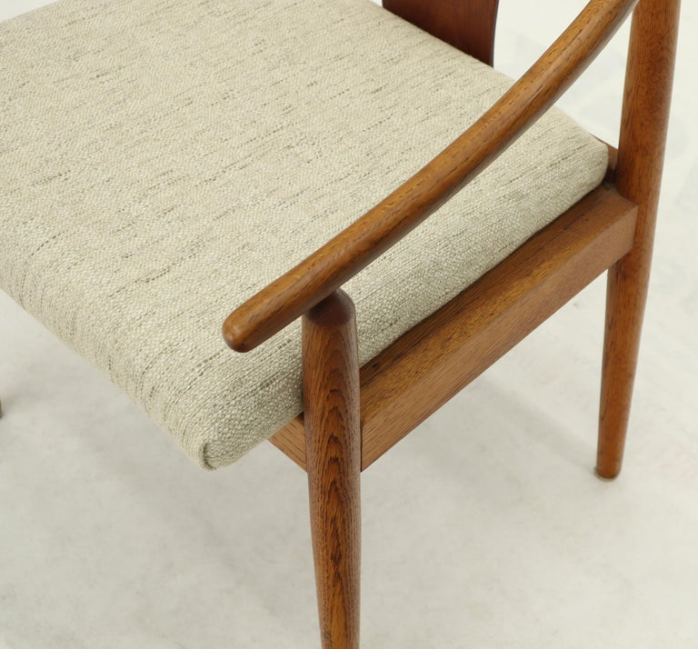 Set of 4 Danish Mid-Century Modern Hans Werner style newly upholstered lounge chairs. Tapered legs with sloping arms features.