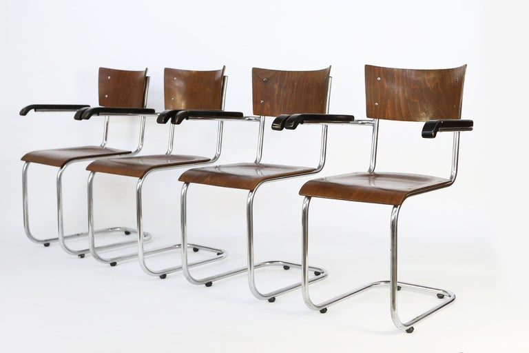 A set of 4 bauhaus cantilever armchairs designed in late 1920s, simultaneously, by Mart Stam, Marcel Breuer and Ludwig Mies van der Rohe.