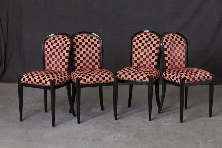 Set of 4 black lacquered hand carved side chairs, model Opera Paris, upholstered in Checkered fabric with brass nailhead trim, designed by Sally Sirkin Lewis for J. Robert Scott, 1990s. The chairs are solid, some scratches and chips to the