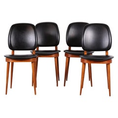 Set of 4 Black Leather Mid-Century Modern Chairs by French Designer Pierre Guari