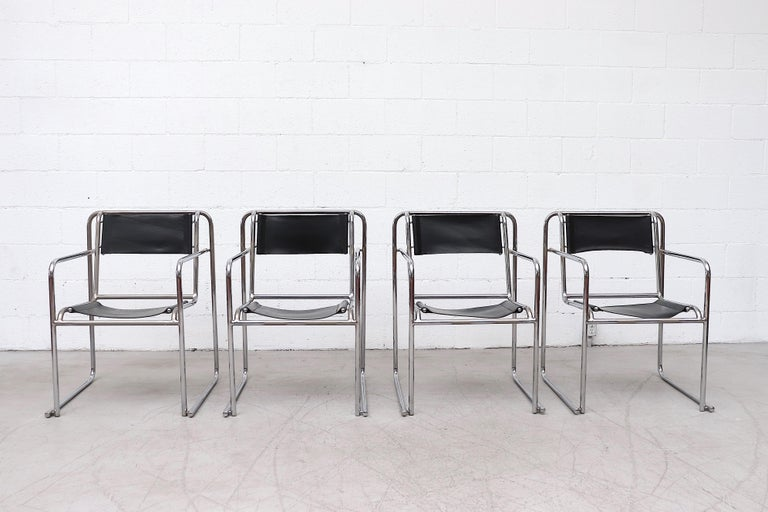 Set of 4 Bruno Polak Bauhaus stacking chairs with tubular chrome frames. In original condition with visible wear to the leather and some chrome loss. Very original condition. Set price.