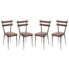 Set of 4 Chairs in Stitched Leather by Jacques Adnet