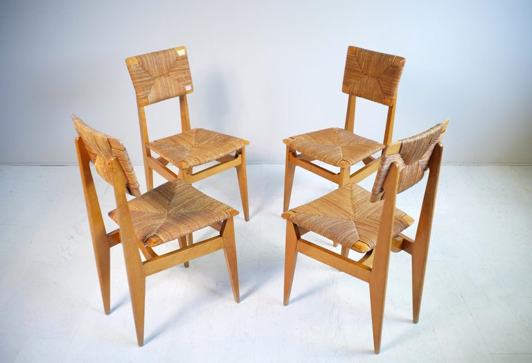 Beautiful set of 4 chairs model C Marcel Gascoin, French reconstruction, 1950. Rare straw version with chamfered back and seat, structure in varnished Beech.