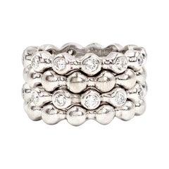 Set of 4 18 Karat White Gold and Diamond CHANEL Stacking Rings