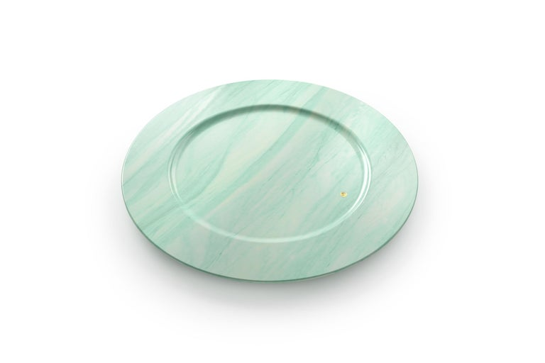 Set of 4 hand carved charger plates from semi-precious green quartzite. Multiple use as charger plates, plates, platters and placers. Dimensions: D 33, H 1.9 cm.  Pieruga proudly creates elegant accessories and complements in marble through