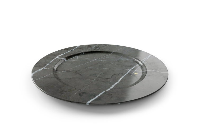 Set of 4 hand carved charger plates from imperial grey marble. Multiple use as charger plates, plates, platters and placers. Dimensions: D 33 H 1.9 cm.  Pieruga proudly creates elegant accessories and complements in marble through artisanal