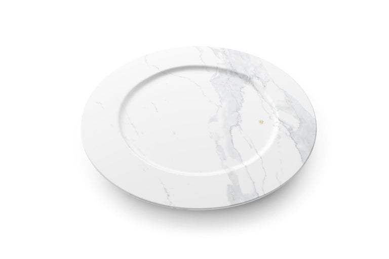 Set of 4 hand carved charger plates from Statuary marble. Multiple use as charger plates, plates, platters and placers. Dimensions: D 33, H 1.9 cm.  The precious white Statuary marble has always been the one preferred by sculptors and artists for