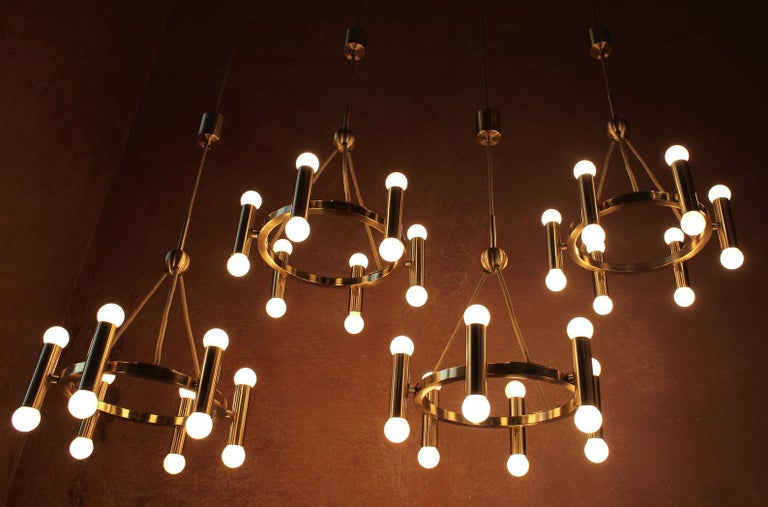 Set of 4 small minimalistic 12 lights (e14) brass chandeliers as special order for a church in Hanover, Germany, 1960s - Sciolari type  Measures: Diameter 16