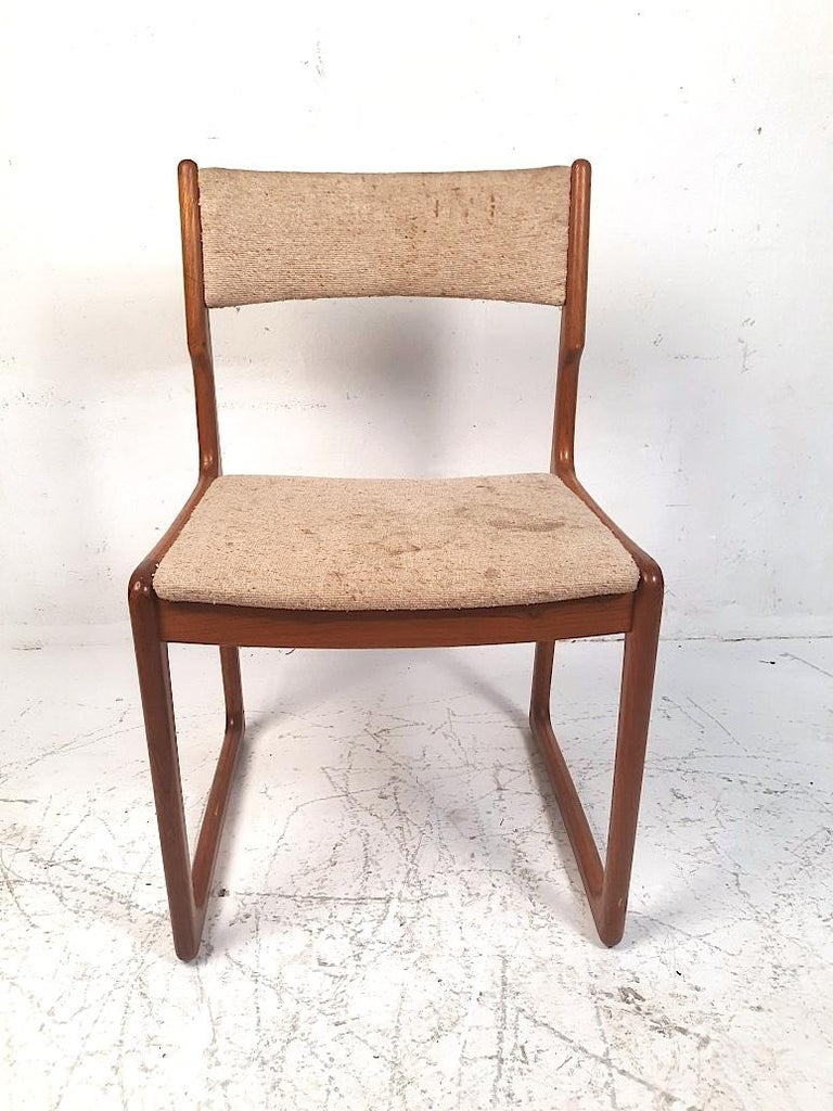 Stylishly simple set of 4 Danish modern dining chairs reminiscent of Benny Linden's designs. Sculpted teak frames with sled legs give this set a great look. Sure to make a great addition to any modern interior. Please confirm item location with