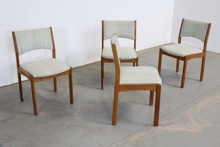 Set of 4 Scandinavian Modern teak side dining chairs  Offered is a vintage set of 4 vintage Danish modern teak side dining chairs with teak backs. This set has simple, but modern lines and could make an excellent addition to any home. They are in