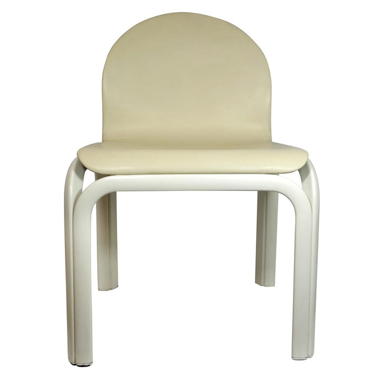 Set of 4 white lacquered aluminum dining chairs named Orsay. They were designed by Gae Aulenti for Knoll International. The chairs have been reupholstered with fine beige leather. Two chairs have armrest, the other two do not.