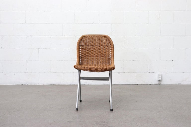 Set of 4 Dirk van Sliedregt rattan woven dining chairs with chrome frames. Original condition, slight imperfections and variations in size and color. Minimal rattan loss, all in original condition. Set price.