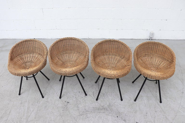 Handsome set of 4 rattan bucket stools with black enameled wire legs. In original condition with minimal breakage and some visible wear to enamel. Set price.