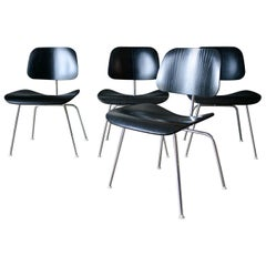 Set of 4 Ebonized Eames DCM Chairs