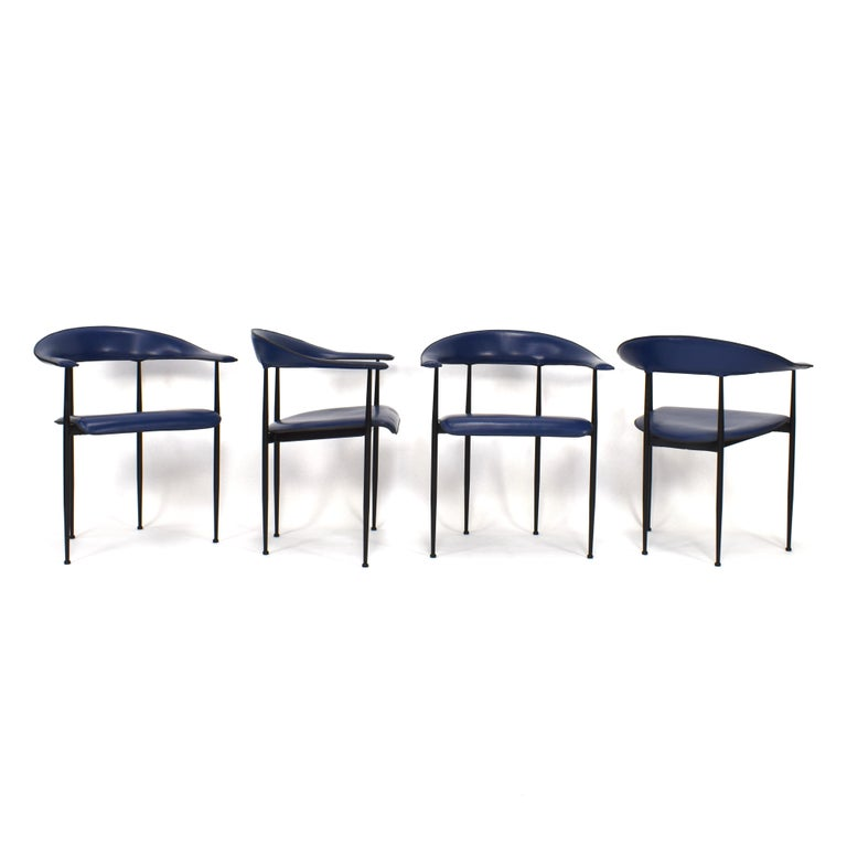 Set of four dark blue leather P40 dining chairs by FASEM Italy.  Designer: Giancarlo Vegni & Gianfranco Gualtierotti  Manufacturer: FASEM  Country: Italy  Model: P40 Dining chairs  Material: Black lacquered metal / Dark blue