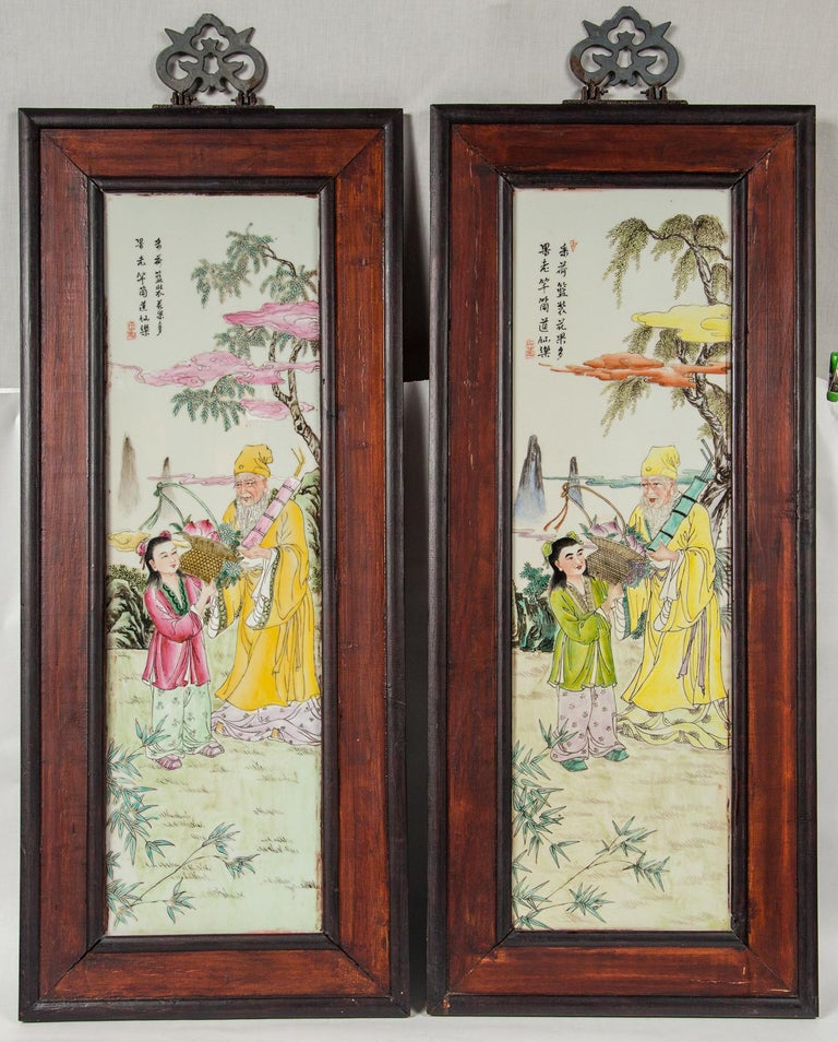 Wooden frames around the 4 plaques, each depicting different figures in a landscape setting.
