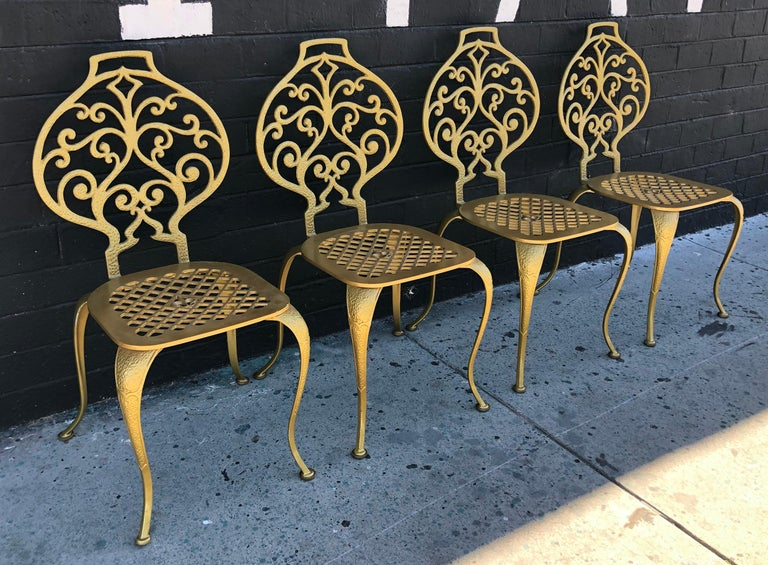 An absolutely stunning set of 4 Thinline dining chairs. The chairs have a solid aluminum body and feature a gorgeous fleur de lis design on the seats. 