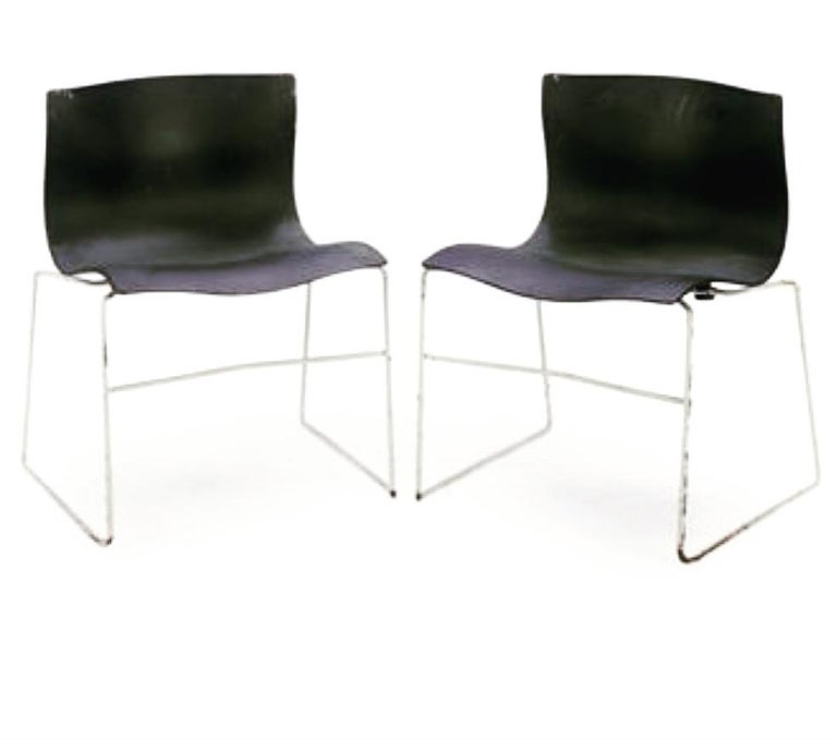 A great set of 4 chairs designed by Massimo Vignelli for Knoll, circa 1983, for Knoll studio great condition complete with rubbers chrome has been polished, the seats are very clean these chairs are nice and comfy. These chairs are stackable for