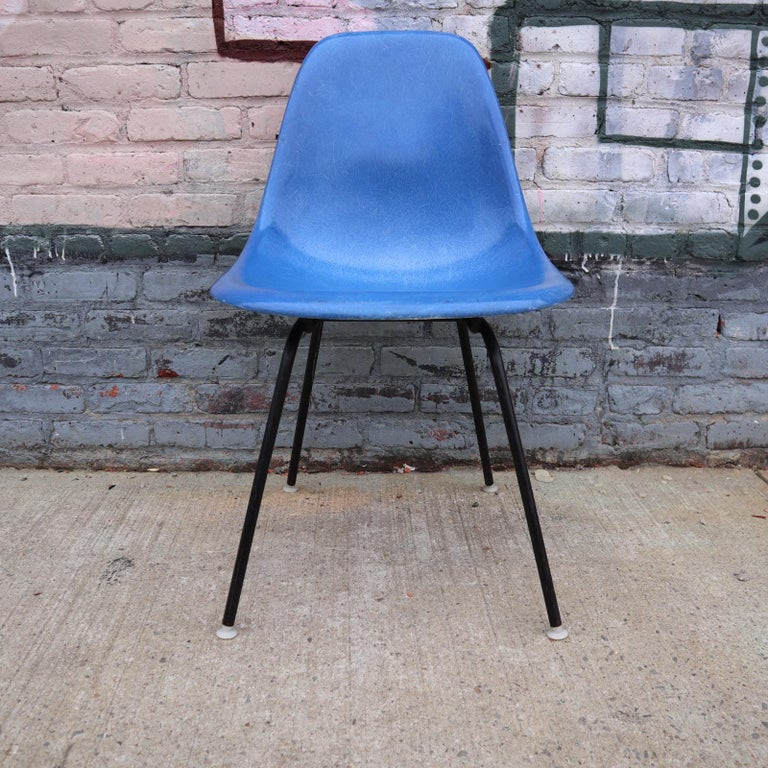 Set of 4 Herman Miller Eames fiberglass dining chairs. In very good vintage condition with normal wear. All new shock mounts installed at $600 value. Bases available in metallic or black (as shown in photos). All chairs signed and from same owner so