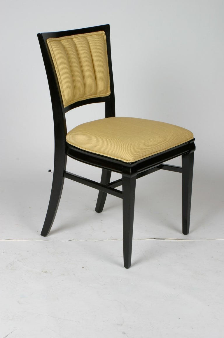 Set of four elegant Hollywood Regency dining side or game chairs in dark espresso mahogany frames. Only one of the four chairs has been refinished, also will be reupholstered with COM, includes new foam. Please allow several weeks for refinishing