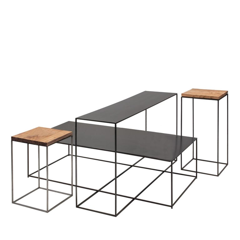 Two delightful small end tables with a solid, aged olive wood top with a wax polish, and two longer side tables with black sablè powder-coated tops with a waxed finish, all with a slender metal structure and black sablè. These pieces are