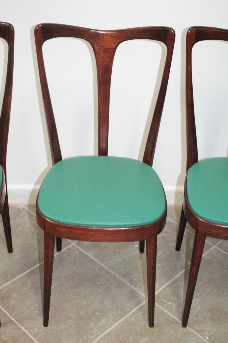 Wonderful set of 4 chairs attributed to Guglielmo Ulrich. Good vintage condition.
