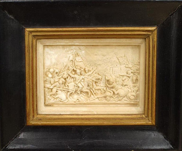 Set of 4 Italian Renaissance style (19th century) carved soapstone wall plaques of Medieval scenes under glass in black frames.