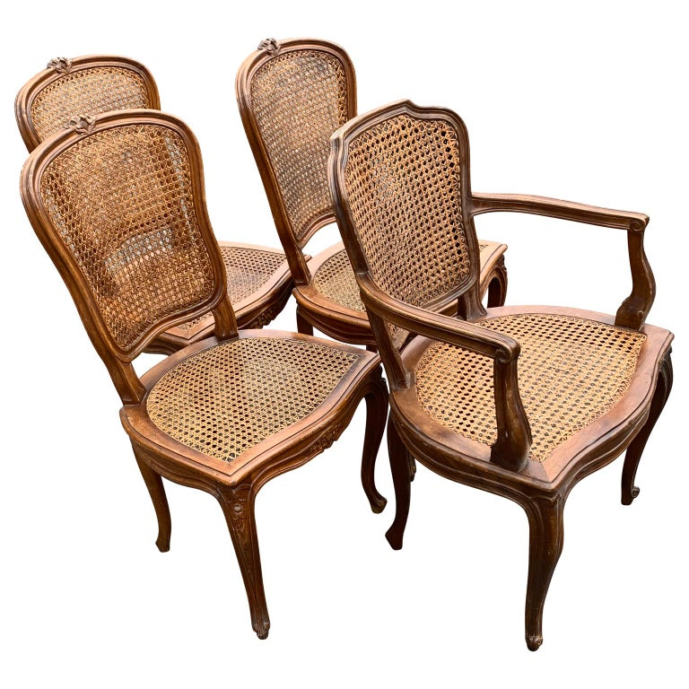 Set of 4 Italian Rococo style dining room chairs  Caning and sturdiness of chairs is in good working conditions  Complimentary front door delivery includes most areas of Washington DC metro, Baltimore, Philadelphia, New Jersey, New York and