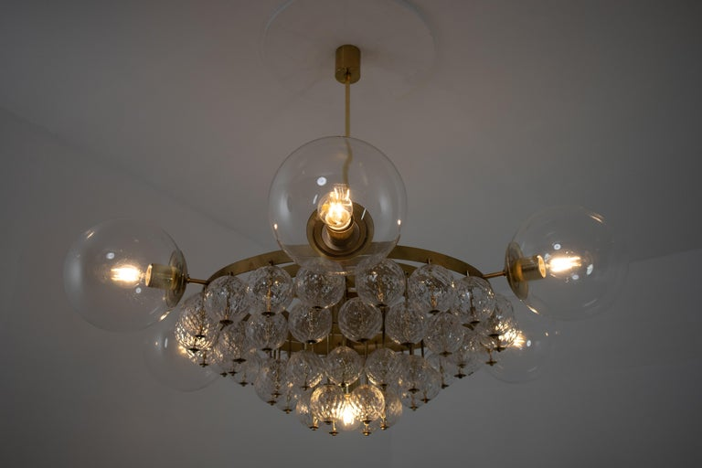 Austrian Set of 4 Large Hotel Chandeliers with Brass Fixture and Structured Glass Globes For Sale