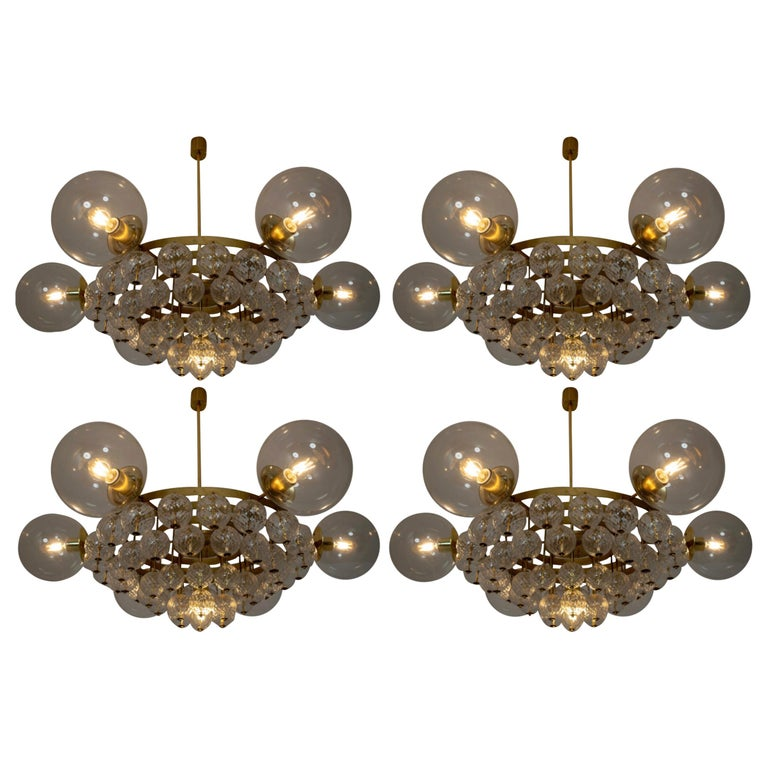 Set of 4 Large Hotel Chandeliers with Brass Fixture and Structured Glass Globes For Sale