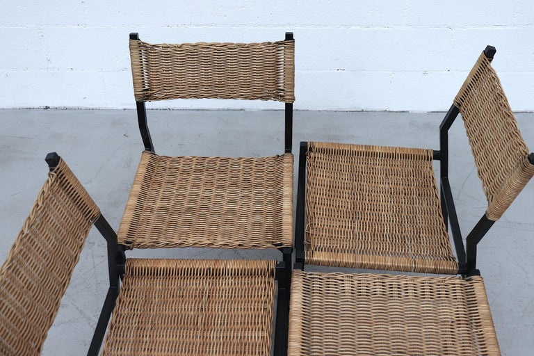 Set of 4 black enameled metal framed Martin Visser dining chairs with woven wicker seat and backrest. Head designer for Spectrum in 1954 with an architectural and engineering background which is reflected in his functional and Industrial designed