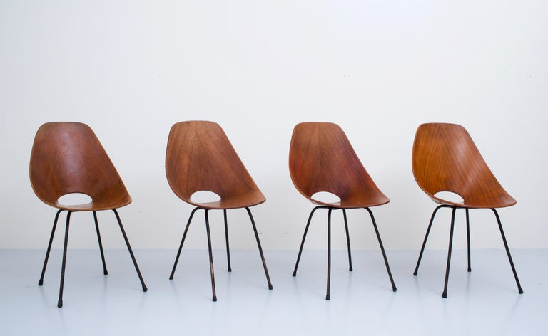 Set of 4 Medea dining chairs by Vitorio Nobili for Fratelli Tagliabue, Italy, 1955  We all know them, it's just a very nice set of chairs. Rounded forms and a natural appearance together with a good balance in the materials, make this one of